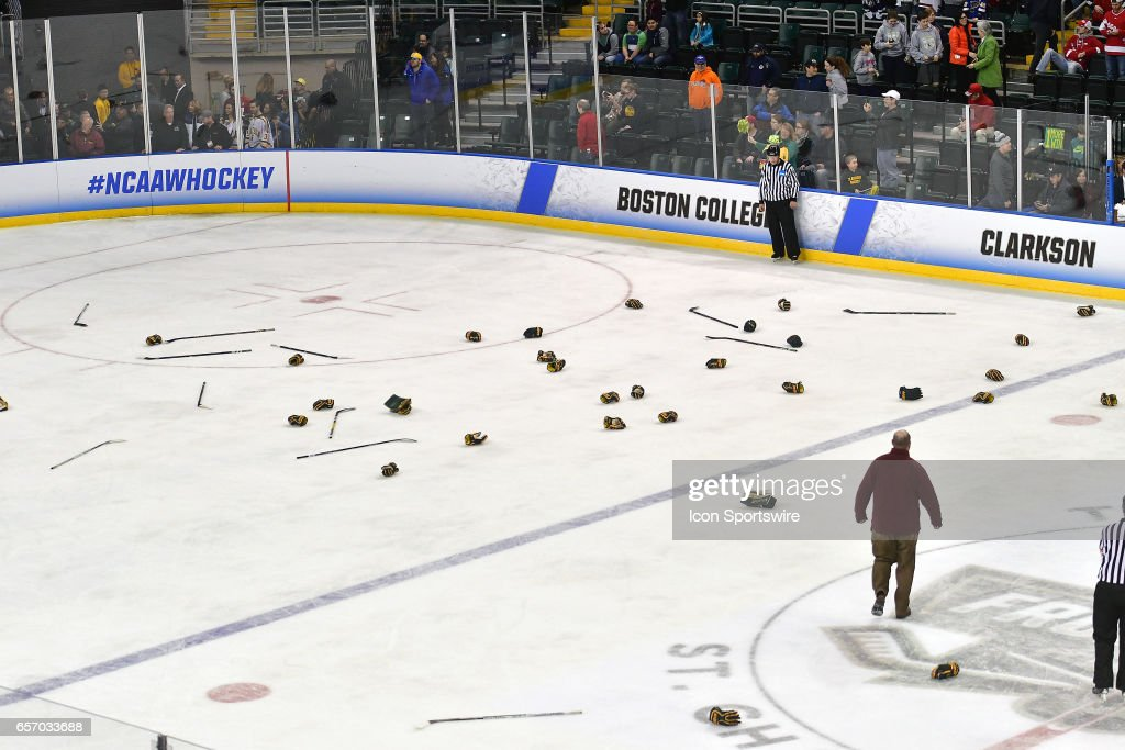 Sticks and gloves cover the ice after Clarkson won the Women's Division 1 Hockey Championship between the Wisconsin Badgers and the Clarkson Golden Knights on March 19, 2017, at the Family Arena in St. Charles, MO.