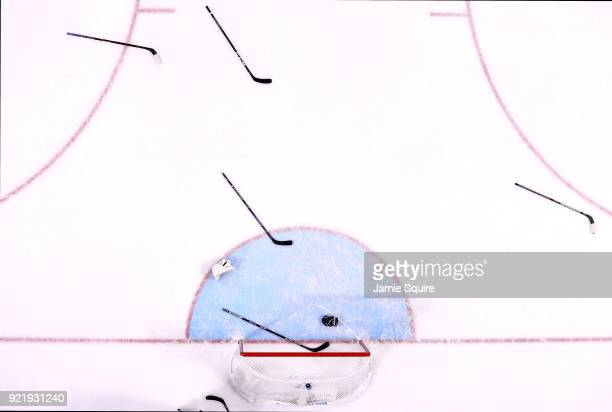 Sticks and gloves sit on the ice after Finland defeated Olympic Athletes from Russia 32 during the Women's Ice Hockey Bronze Medal game on day twelve...
