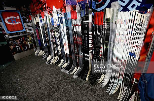 Sticks are seen in the locker room of the Montreal Canadiens prior to the 2016 Bridgestone NHL Winter Classic between the Montreal Canadiens and the...