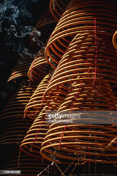 sticks burning in temple - incense coils stock pictures, royalty-free photos & images