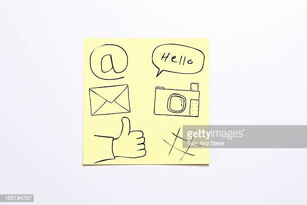 Sticky note with social media icons drawn on it