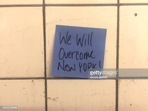 Sticky notes hanging in the subway station 14th street as part of the art project 'Subway Therapy' by artist Matthew Chavez in New York US 10...