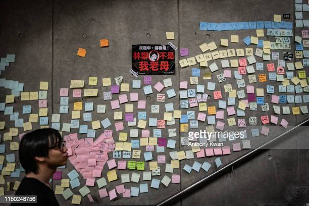 Sticky notes written by protesters and a placards is seen on a wall during a rally against the nowsuspended extradition bill on June 16 2019 in Hong...