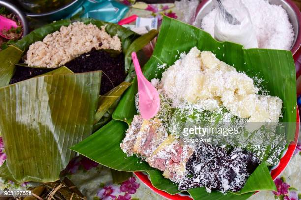 Sticky rice cakes covered with coconut shaves in Laos
