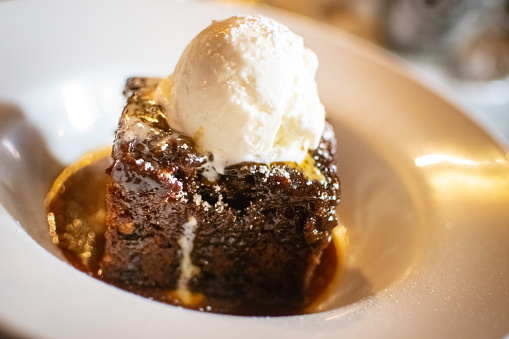 Sticky toffee pudding served with ice-cream 1018011508