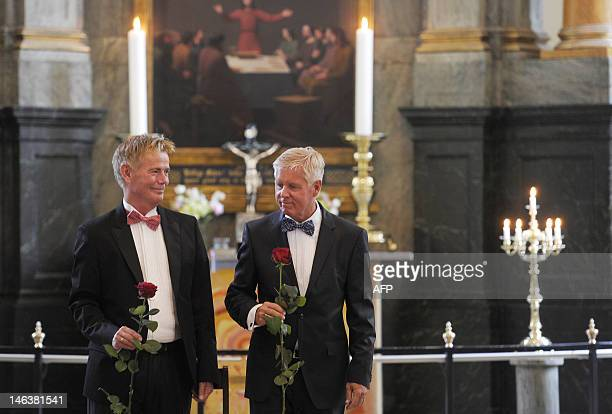 Stig Ellins and his partner Steen Andersen pose with a rose after their wedding at Frederiksberg church in Copenhagen on June 15 2012 Denmark a...