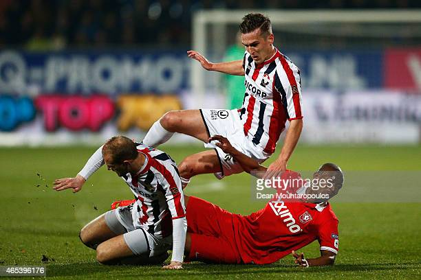 Stijn Dijks and Frank Van der Struijk of Willem II and Kamohelo Mokotjo of Twente colide going for the ball during the Dutch Eredivisie match between...