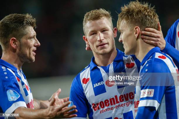 Stijn Schaars of Heerenveen Doke Schmidt of Heerenveen Martin Odegaard of Heerenveen celebrate the victory during the Dutch Eredivisie match between...