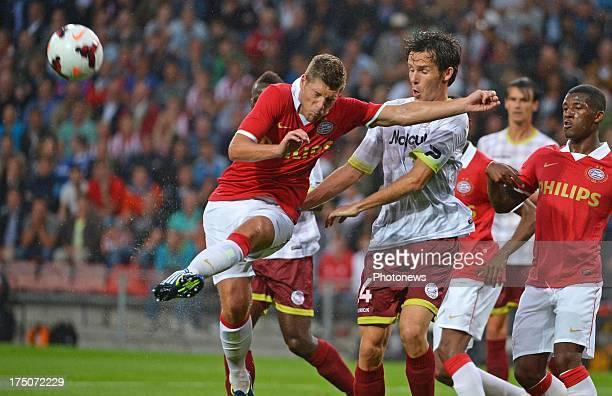 Stijn Schaars of PSV and Karel D'Haene of SV Zulte Waregem during the UEFA Champions League Third qualifying round match first leg between PSV...