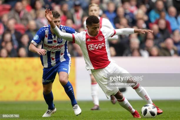 Stijn Schaars of SC Heerenveen David Neres of Ajax during the Dutch Eredivisie match between Ajax v SC Heerenveen at the Johan Cruijff Arena on March...