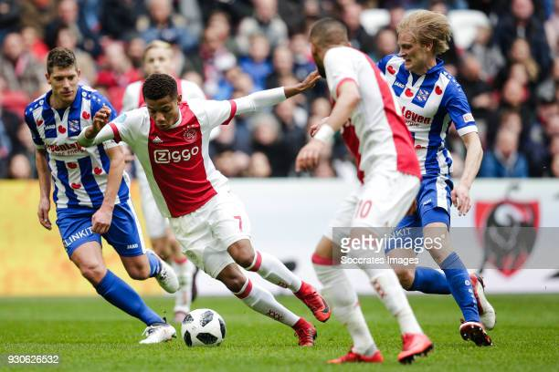 Stijn Schaars of SC Heerenveen David Neres of Ajax Morten Thorsby of SC Heerenveen during the Dutch Eredivisie match between Ajax v SC Heerenveen at...