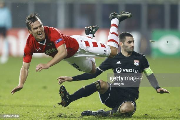Stijn Wuytens of AZ Alkmaar Maxime Gonalons of Olympique Lyonduring the UEFA Europa League round of 32 match between AZ Alkmaar and Olympique...