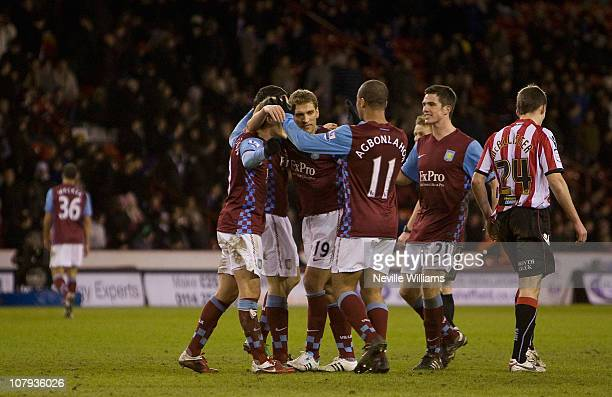 Stiliyan Petrov celebrates with his team mates after scoring a goal during the FA Cup Sponsored by EON 3rd round match between Sheffield United and...