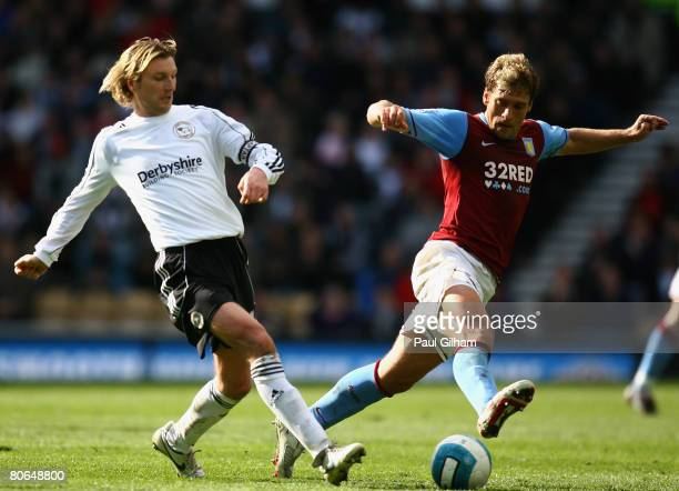 Stiliyan Petrov of Aston Villa battles for the ball with Robbie Savage of Derby County during the Barclays Premier League match between Derby County...