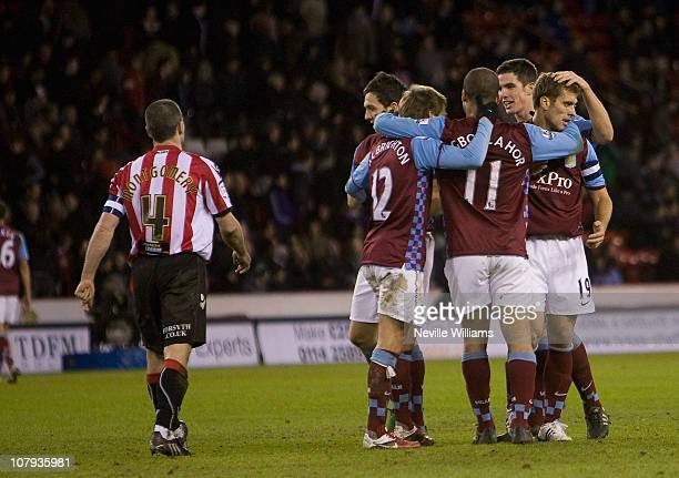 Stiliyan Petrov of Aston Villa celebrates with teammates after scoring the 31 goal during the FA Cup Sponsored by EON 3rd round match between...