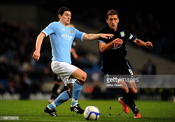 Stiliyan Petrov of Aston Villa competes with Gareth Barry of Manchester City during the FA Cup sponsored by EOn Fifth Round match between Manchester...