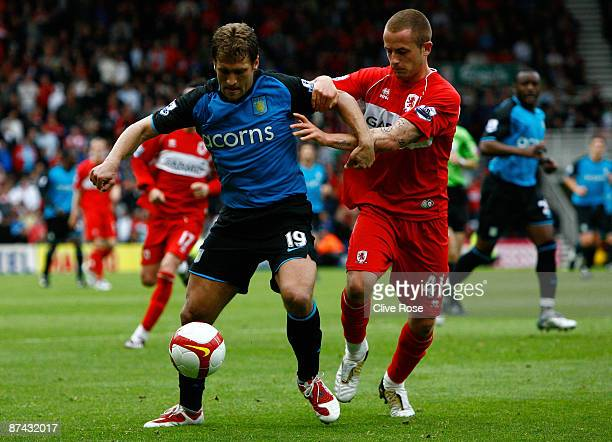 Stiliyan Petrov of Aston Villa is challenged by Josh Walker of Middlesbrough during the Barclays Premier League match between Middlesbrough and Aston...