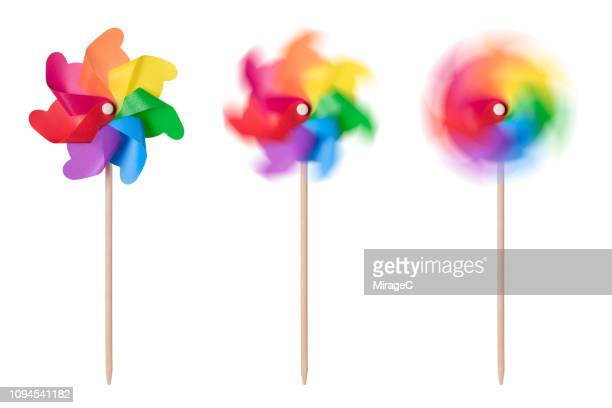 still and spinning pinwheel toys - paper windmill stock photos and pictures