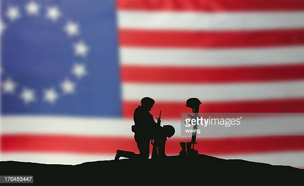 still fighting for freedom - soldier praying stock photos and pictures