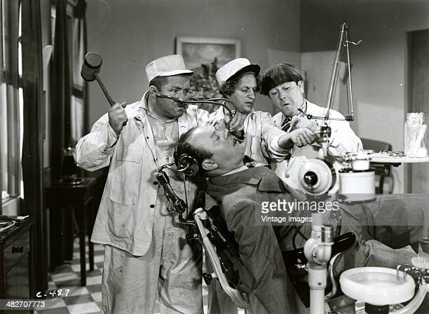 A still from a film starring The Three Stooges Larry Moe and Curly as dentists circa 1935