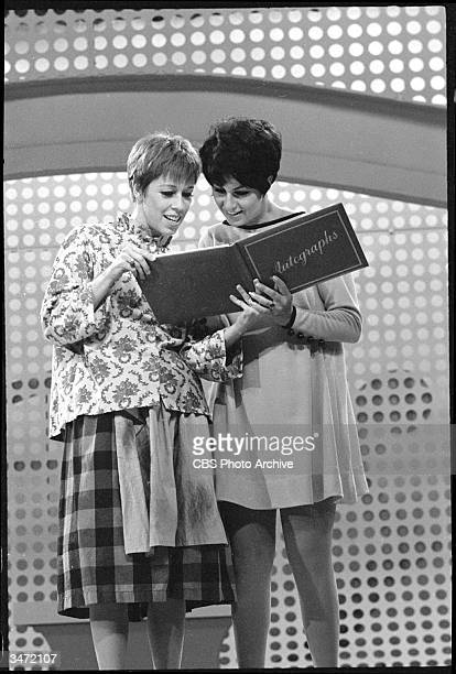 Still from 'The Carol Burnett Show' features American comedienne and actress Carol Burnett and her guest Lainie Kazan who signs Burnett's autograph...