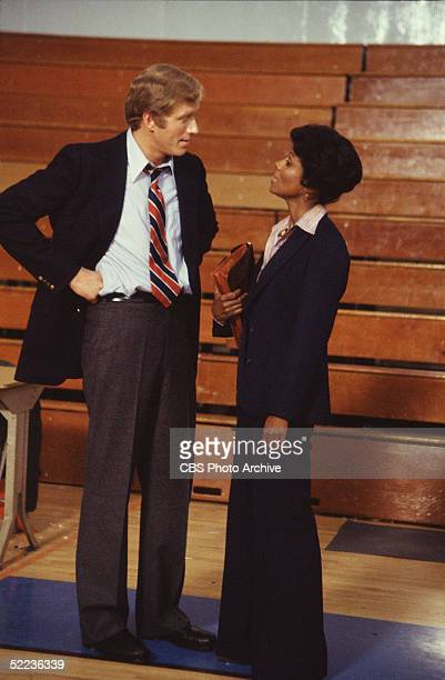 Still from the CBS dramatic television series 'The White Shadow' shows American actors Ken Howard and Joan Pringle as they stand and talk in front of...