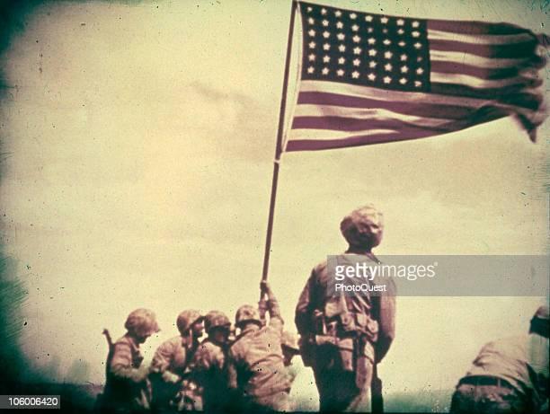 A still from the film shot by Marine photographer Bill Genaust of soldiers raising the United States flag at Iwo Jima February 23 1945