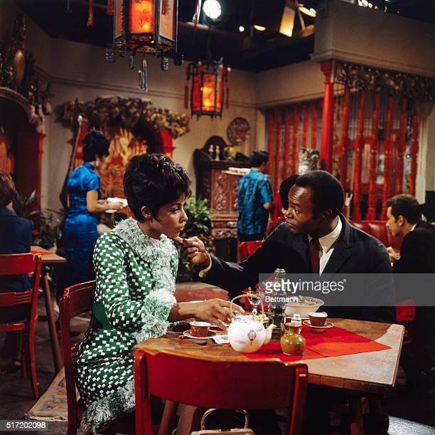 TV still from the series Julia showing Diahann Carroll and another actor in a restaurant