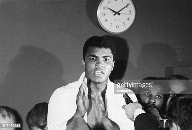 Still heavyweight champion of the world Cassius Clay demonstrates the Ali Shuffle after successfully defending his title against Texas challenger...