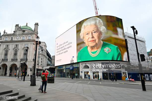 A still image of Britain's Queen Elizabeth II with a message of hope from her special address to the nation is seen on the giant billboard in...