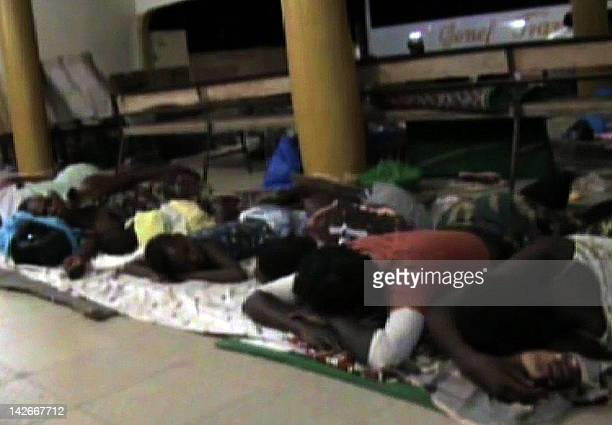 Still image taken from AFPTV video footage released on April 11, 2012 shows people sleeping at a bus station in Gao on March 31, 2012 as they await...
