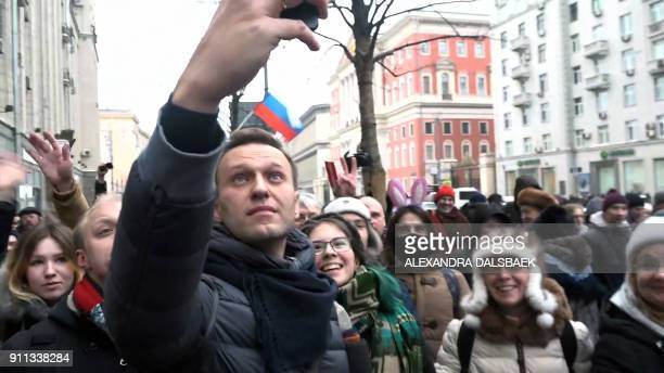 TOPSHOT A still image taken from an AFPTV footage shows opposition leader Alexei Navalny taking a selfie photograph during a rally calling for a...