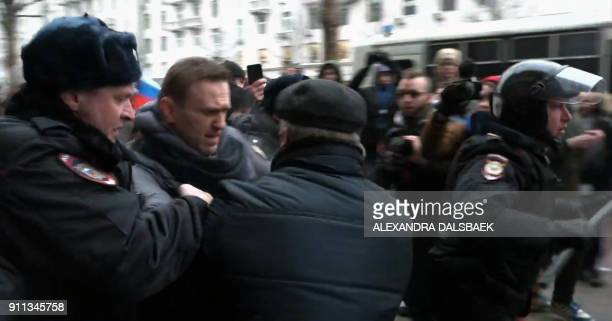 TOPSHOT A still image taken from an AFPTV footage shows police officers detaining opposition leader Alexei Navalny during a rally calling for a...