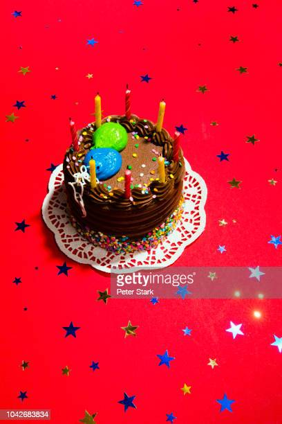 still life chocolate birthday cake and star confetti - chocolate cake above stock pictures, royalty-free photos & images