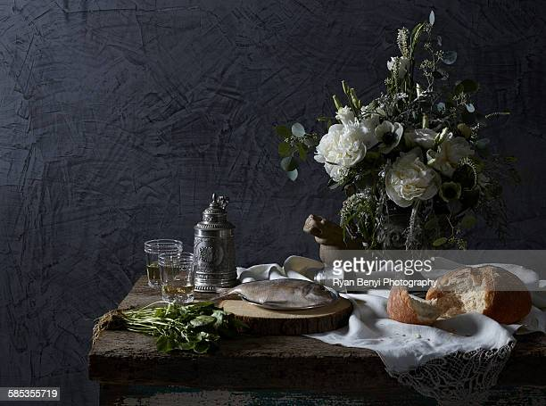 still life dutch masters theme with white wine, watercress, bread and fish - nature morte photos et images de collection