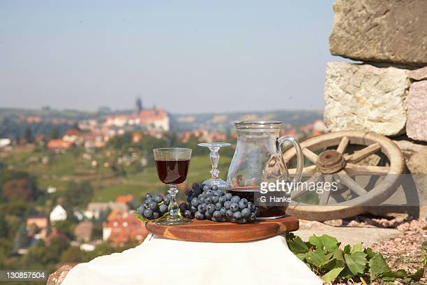 Still life, food and wine, grapes, wine bottle, wine glasses, Meissen and Albrechtsburg castle and Meissen Cathedral at the back, view towards the Elbe river, on a vineyard, Saxony, Germany, Europe