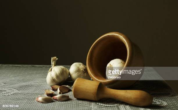 Still life garlics and a mortar on a lace tablecloth