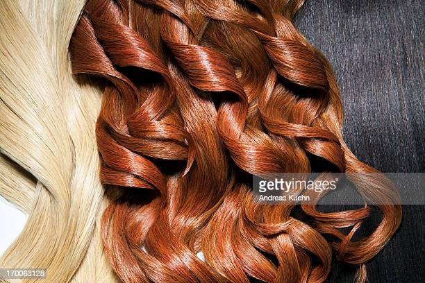 still life of 3 different hair colors. close up. - straight hair stock pictures, royalty-free photos & images