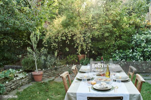 still life of a dressed dining table set for six people. - garden stock pictures, royalty-free photos & images
