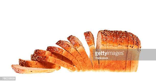 Still life of a sliced loaf of bread.