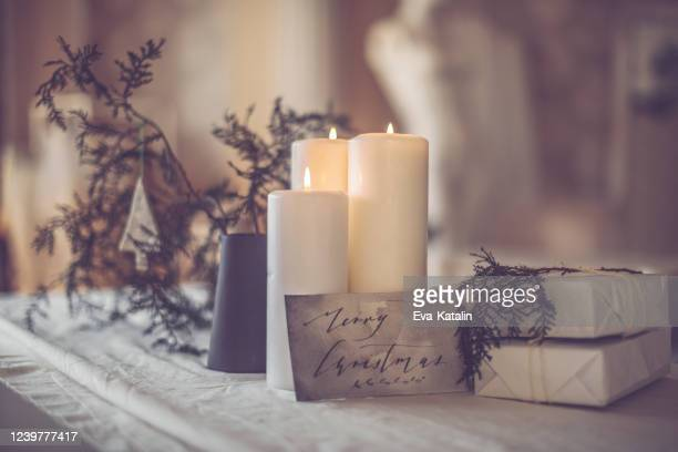 still life of a table setting for a christmas event - christmas decore candle stock pictures, royalty-free photos & images