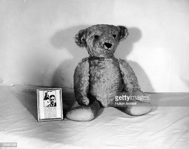 Still life of a 'Teddy' Bear sitting with its tag describing the origin of the toy and US president Theodore Roosevelt, 1950s.