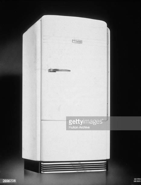 Still life of a white streamlined Hotpoint refrigerator
