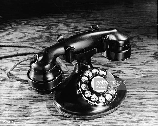 Still life of an oldfashioned black rotary telephone 1930s