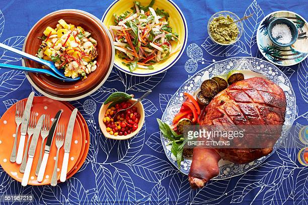 still life of baked creole ham and side dishes - caribbean culture stock pictures, royalty-free photos & images