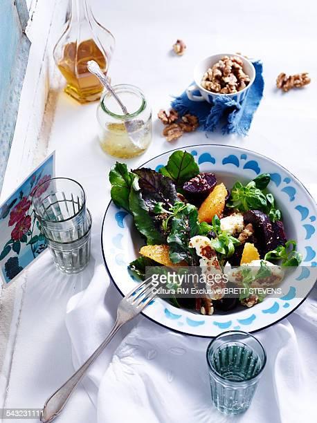 Still life of beetroot, halloumi and walnut salad