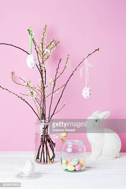 still life of blossom twigs, easter bunny and birds - dekoration stock-fotos und bilder