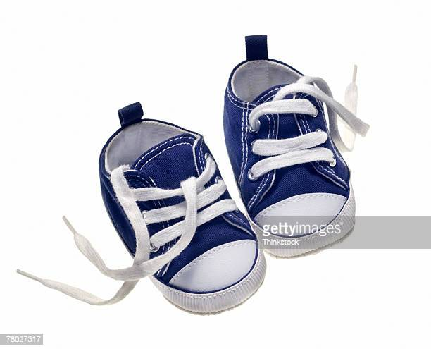 Still life of blue baby sneaker shoes.