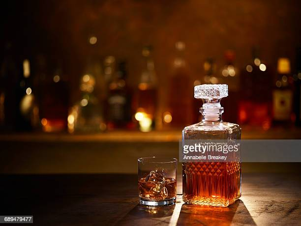 still life of bourbon whiskey on bar - whisky stock photos and pictures