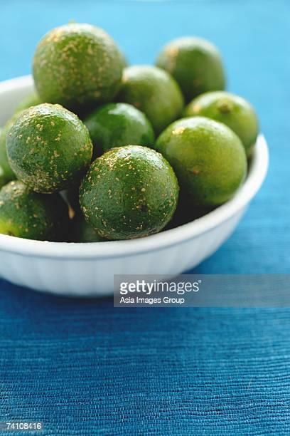 Still life of bowl of limes